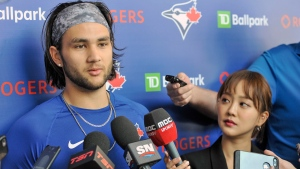 Toronto Blue Jays infielder Bo Bichette talks to reporters at the team's spring training facilities in Dunedin, Fla., Saturday, Feb. 15, 2020. THE CANADIAN PRESS/Steve Nesius