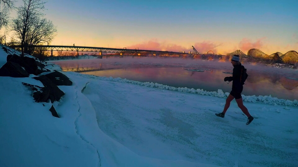 Joan Roch runs across the icy St. Lawrence