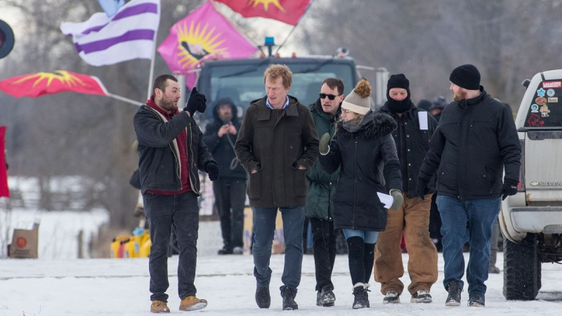 Indigenous Services Minister Marc Miller, second from left, leaves following a meeting with protesters at a rail blockade on the tenth day of demonstration in Tyendinaga, near Belleville, Ont., Saturday, Feb. 15, 2020. The protest is in solidarity with the Wet'suwet'en hereditary chiefs opposed to the LNG pipeline in northern British Columbia. THE CANADIAN PRESS/Lars Hagberg
