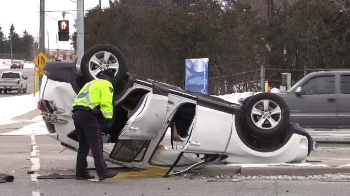 A vehicle ended up on its roof following a two-vehicle crash in Kitchener. (Adam Marsh/CTV Kitchener) (Feb. 15, 2020)