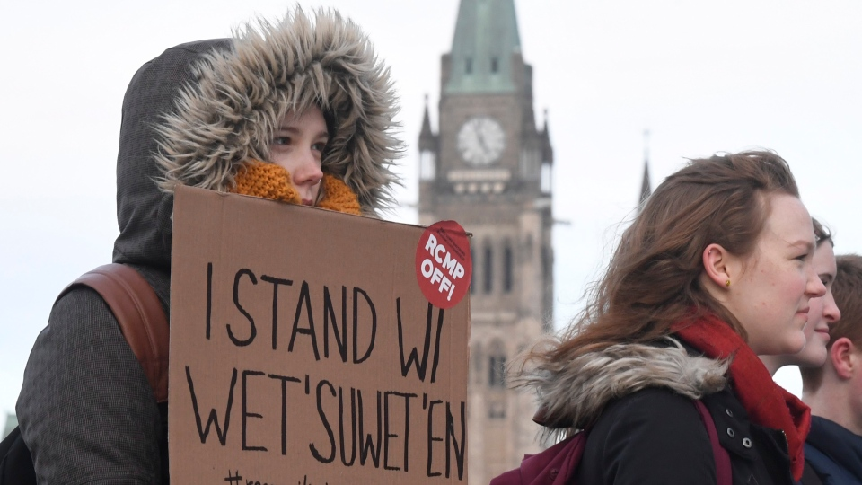 Protesters in solidarity with the Wet'suwet'en hereditary chiefs opposed to the LNG pipeline in northern British Columbia block an Ottawa intersection Wednesday, Feb. 12, 2020. THE CANADIAN PRESS/Adrian Wyld