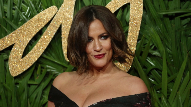 Presenter Caroline Flack poses upon arrival at The British Fashion Awards 2017 in London, Monday, Dec. 4th, 2017. (AP Photo/ Joel C Ryan)