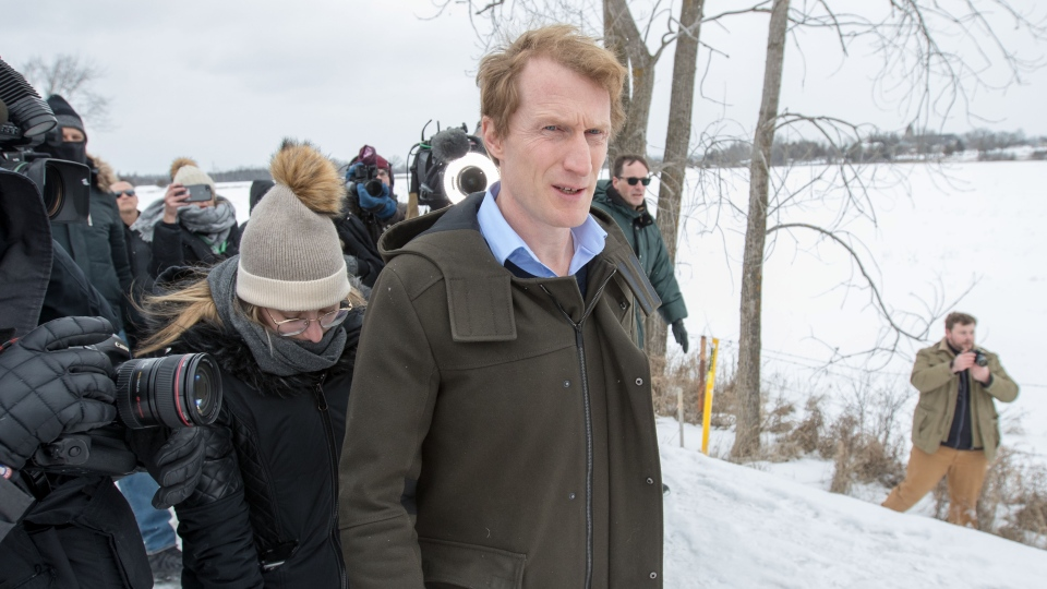 Indigenous Services Minister Marc Miller is surrounded by media as he arrives for a meeting with protesters at a rail blockade on the tenth day of demonstration in Tyendinaga, near Belleville, Ont., Saturday, Feb. 15, 2020. THE CANADIAN PRESS/Lars Hagberg