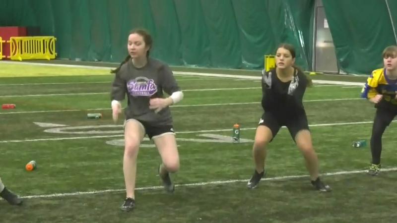 Female footballers tackling barriers
