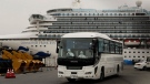 A bus leaves a port where the quarantined Diamond Princess cruise ship is docked Saturday, Feb. 15, 2020, in Yokohama, near Tokyo. THE CANADIAN PRESS/AP-Jae C. Hong