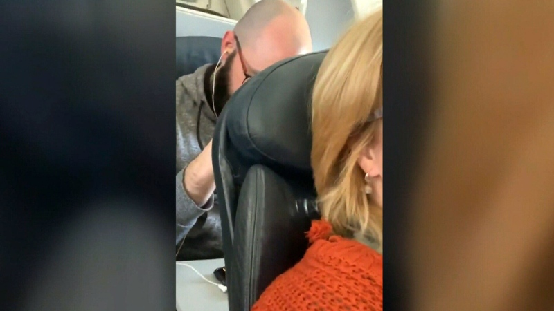 Wendi Williams, who said she's a teacher in Virginia Beach, tweeted footage of a man repeatedly hitting the back of her reclined seat with his fist during an American Airlines flight in January.