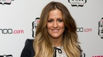In this file photo dated Thursday, Nov. 3, 2011, British TV personality Caroline Flack arrives for the Cosmopolitan Ultimate Women of the Year Awards in London. (AP Photo/Jonathan Short, FILE)