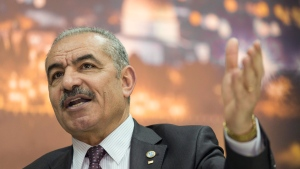 In this April 16, 2019 file photo, Palestinian Prime Minister Mohammad Shtayyeh gives an interview with The Associated Press, at his office in the West Bank city of Ramallah. (AP Photo/Nasser Nasser)