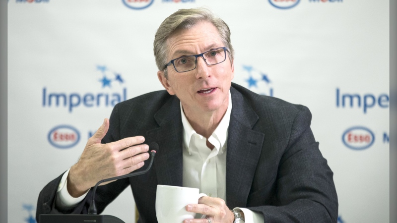 Rich Kruger answers questions during a news conference in Calgary in December during one of his last audiences with reporters before retiring as CEO of Calgary-based Imperial Oil Ltd. (Todd Korol/The Canadian Press)