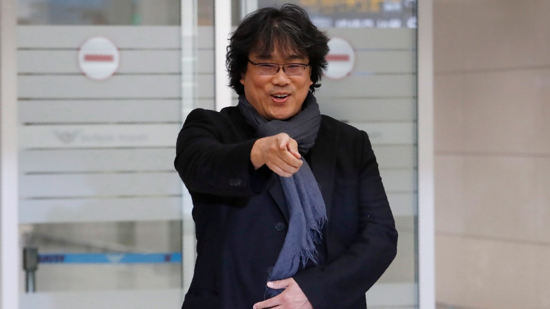 South Korean director Bong Joon-ho gestures upon his arrival at the Incheon International Airport in Incheon, South Korea, Sunday, Feb. 16, 2020. (AP Photo/Ahn Young-joon)