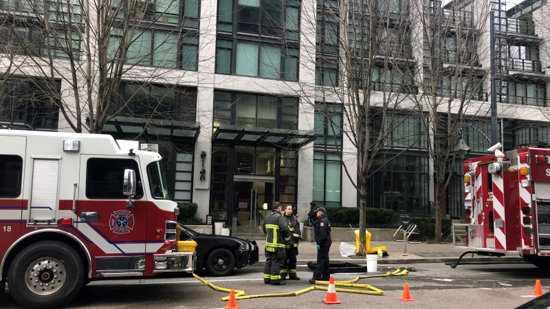 Vancouver police detectives executed a search warrant at a Yaletown condo on Sunday, Feb. 16, 2020, with the support Vancouver Fire and Rescue Services and a hazmat team because of the possibility that fentanyl could be present. (CTV)