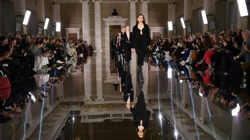Victoria Beckham, who was supported by her family, said her latest collection, on show at London Fashion Week, said her creations comprise a 'gentle rebellion.' (AFP)