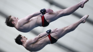 Canada's Laurent Gosselin-Paradis, top, and Ethan Pitman compete during the men's 10-metre open synchro finals event at the FINA Diving Grand Prix in Calgary, Alta., Sunday, April 7, 2019.THE CANADIAN PRESS/Jeff McIntosh