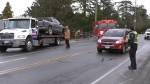 The crash slowed traffic on Admirals Road while police investigated and crews worked to remove the truck. (CTV)