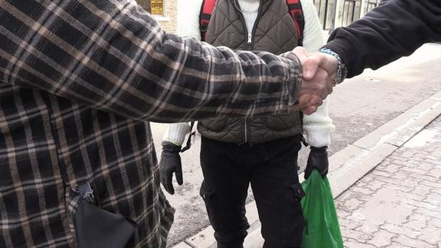 Volunteers walk through Brantford handing out kindness