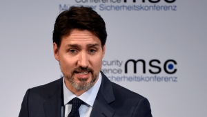 Justin Trudeau, Prime Minister of Canada speaks on the first day of the Munich Security Conference in Munich, Germany, Friday, Feb. 14, 2020. (AP Photo/Jens Meyer)b