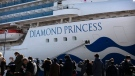 Media gather outside the quarantined Diamond Princess cruise ship in Yokohama, near Tokyo, Tuesday, Feb. 11, 2020. Japan's Health Minister Katsunobu Kato said the government was considering testing everyone remaining on board and crew on the Diamond Princess, which would require them to remain aboard until results were available. (AP Photo/Jae C. Hong)