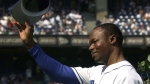 Toronto Blue Jays' Tony Fernandez tips his hat to the crowd as he takes part in a pre-game ceremony against the Tampa Bay Rays in Toronto Sunday September 23, 2001. Fernandez is in critical condition in a Florida hospital due to complications from a kidney disease. THE CANADIAN PRESS/Aaron Harris