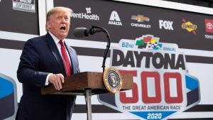 U.S. President Donald Trump speaks before the start of the NASCAR Daytona 500 auto race at Daytona International Speedway, Sunday, Feb. 16, 2020, in Daytona Beach, Fla. (AP Photo/Alex Brandon)