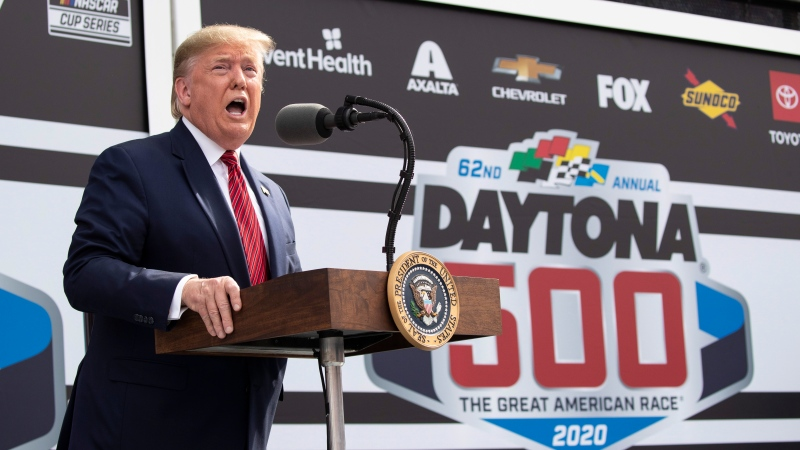 U.S. President Donald Trump speaks before the start of the NASCAR Daytona 500 auto race at Daytona International Speedway, Sunday, Feb. 16, 2020, in Daytona Beach, Fla. (AP Photo/Alex Brandon)