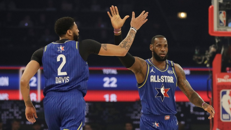 LeBron James of the Los Angeles Lakers high fives Anthony Davis of the Los Angeles Lakers uring the first half of the NBA All-Star basketball game Sunday, Feb. 16, 2020, in Chicago. (AP Photo/Nam Huh)