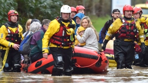 Rescue operations continue as emergency services take residents to safety, in Nantgarw, Wales, Sunday Feb. 16, 2020. (Ben Birchall/PA via AP)