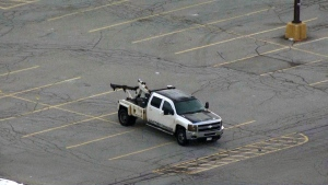 A tow truck is seen in an empty parking lot in an undated file image.