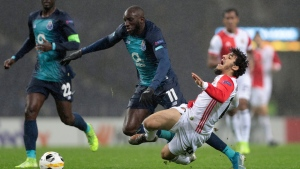 Porto's Moussa Marega fouls Feyenoord's Yassin Ayoub, right, during the Europa League group G soccer match between FC Porto and Feyenoord at the Dragao stadium in Porto, Portugal, Thursday, Dec. 12, 2019. (AP Photo/Miguel Angelo Pereira)