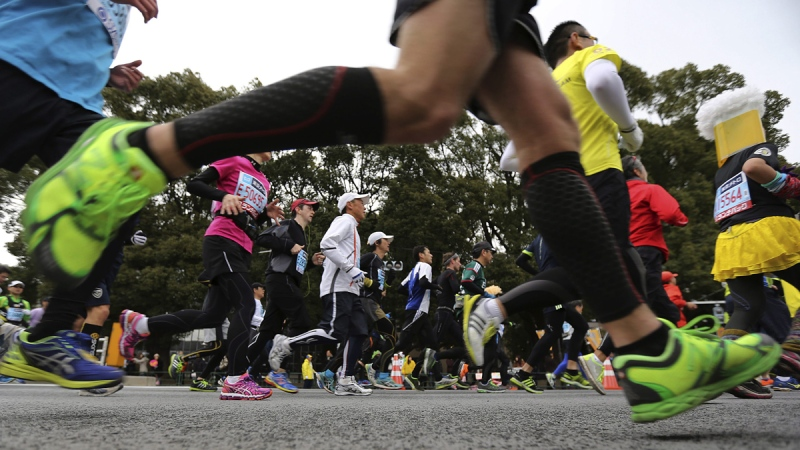 Runners compete during the Tokyo Marathon in Tokyo, on Feb. 23, 2014. (Eugene Hoshiko / AP)
