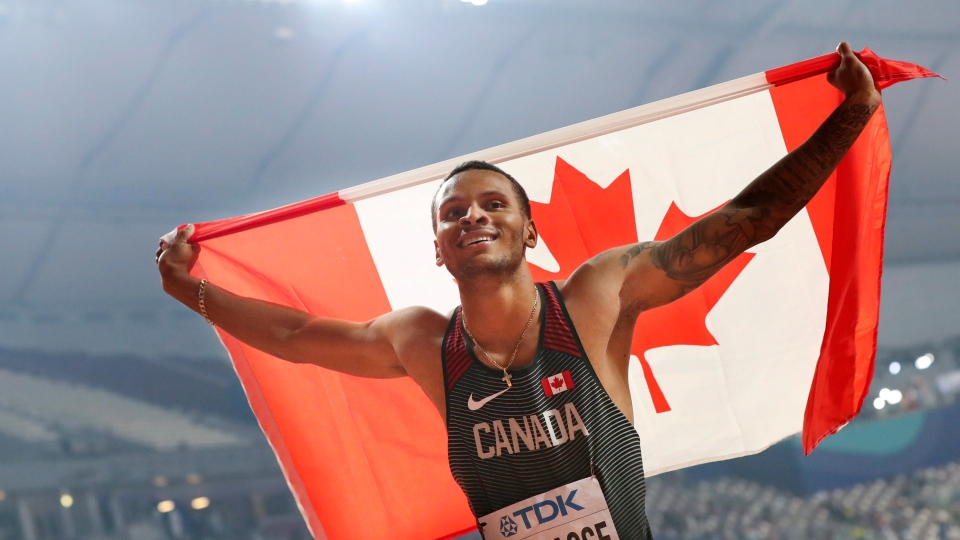 Andre de Grasse, of Canada, celebrates after winning the silver medal in the men's 200 meters at the World Athletics Championships in Doha, Qatar, Tuesday, Oct. 1, 2019. (AP Photo/Hassan Ammar)
