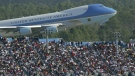 FILE - In this Feb. 15, 2004, file photo, Air Force One rises above the packed grand stands along the super stretch at Daytona International Speedway in Daytona Beach, Fla. (Jim Tiller / Daytona Beach News-Journal Pool via AP)