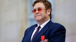 Elton John said walking pneumonia was the reason he couldn't finish a performance in Auckland, New Zealand. (LEWIS JOLY/AFP/Getty Images)