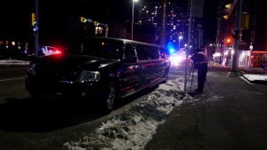 A CPS member photographs a limousine after a man fell from the vehicle along 11th Avenue S.W. on Feb. 16, 2020