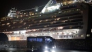 A bus carrying passengers from the quarantined Diamond Princess cruise ship leaves a port in Yokohama, near Tokyo, Monday, Feb. 17, 2020. About 380 Americans are on the cruise ship. The Japanese defense ministry said around 300 of them were preparing Sunday night to leave on buses to take them to Tokyo's Haneda Airport. The U.S. State Department has arranged for charter flights to fly the Americans back to the United States. Canada, Hong Kong and Italy said they were planning similar flights of passengers. (AP Photo/Jae C. Hong)