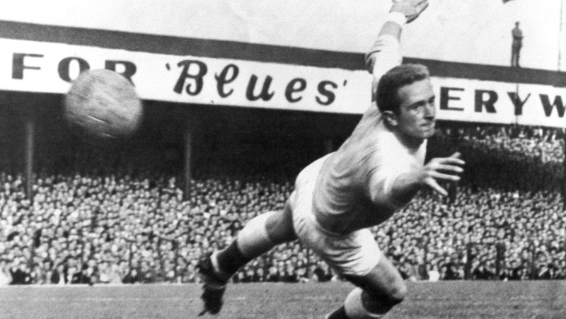 Northern Ireland and Manchester United goalkeeper, Harry Gregg, dives to save the ball during the international soccer match between Northern Ireland and Scotland at Windsor Park, Belfast, in this Oct. 3, 1959 file photo. (AP Photo/File)
