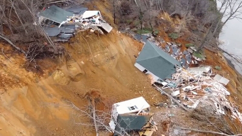 Caught on cam: House collapses during landslide