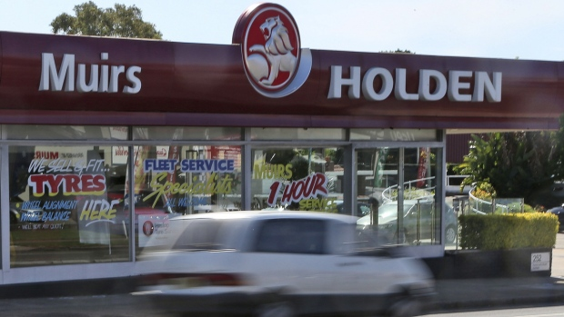 A car drives past a car dealership of Holden, General Motors Co.'s Australian subsidiary, in Sydney, Australia, on Dec. 11, 2013. (Rob Griffith / AP)