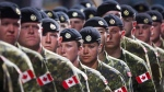 Members of the Canadian Armed Forces march during the Calgary Stampede parade in Calgary, Friday, July 8, 2016. THE CANADIAN PRESS/Jeff McIntosh