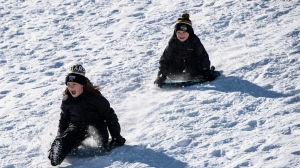Kids go tobogganing at Lansdowne Park in Ottawa on Family Day, Monday, Feb. 17, 2020. (Justin Tang/The Canadian Press)
