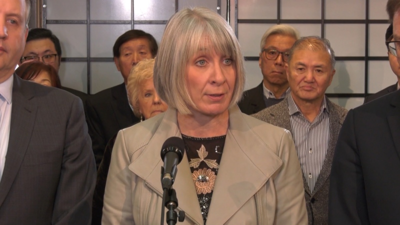 Federal health minister Patty Hajdu met with business owners in Vancouver on Feb. 17, 2020.