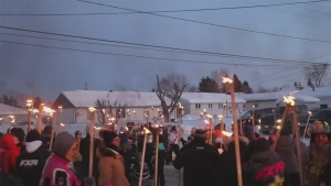 Watch sights and sounds from Cochrane Winter Carnival's annual Torchlight Parade.