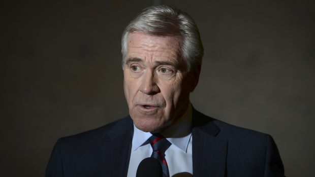 In this file photo, Dwight Ball talks to reporters after meeting with Prime Minister Justin Trudeau on Parliament Hill in Ottawa on November 26, 2019. Ball has announced that he will be stepping down as Premier of Newfoundland and Labrador. THE CANADIAN PRESS/Sean Kilpatrick
