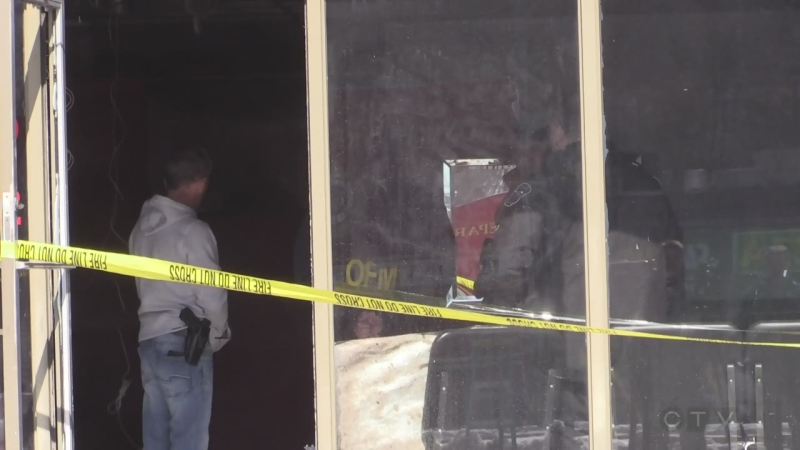 Damage from a blast is seen at a Commissioners Road strip mall