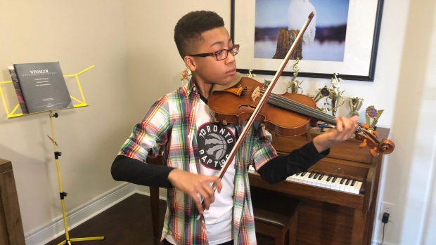 Lincoln Haggart-Ives plays the violin on Feb. 17, 2020. (Mike Walker/CTV News Toronto)