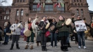 People gather outside of Queen's Park during a Family Day march in support of the Wet'suwet'en hereditary chiefs in Toronto on Monday, February 17, 2020. THE CANADIAN PRESS/ Tijana Martin