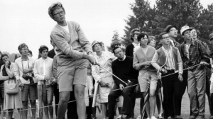 In this 1967 file photo, the gallery follows Mickey Wright's iron shot from the fairway at the Toronto Golf Club. (AP Photo, File)