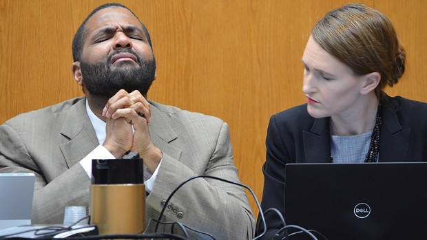 Defendant Willie Cory Godbolt, left, reacts during testimony from his 12-year-old daughter, My'Khyiah Godbolt, that he beat her while defense attorney Katherine Poor comforts him, on Monday, Feb. 17, 2020, during the third day of his capital murder trial at the Pike County Courthouse in Magnolia, Miss. Godbolt, 37, is on trial, for the May 2017 shooting deaths of eight people in Brookhaven. (Donna Campbell/The Daily Leader via AP, Pool)