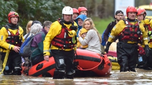 "Rescue operations continue as emergency services take residents to safety, in Nantgarw, Wales, Sunday Feb. 16, 2020. Storm Dennis is roaring across Britain with high winds and heavy rains, prompting authorities to issue 350 flood warnings, including a ""red warning"" alert for life-threatening flooding in south Wales. (Ben Birchall/PA via AP)"