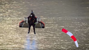 "The carbon fibre wings worn by daredevil Vince Reffet for his ""Jetman"" stunt in Dubai are powered by four mini jet engines that he can control by his movements. (AFP)"