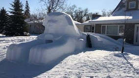Gord Amirault's 24-foot long snow sphinx, complete with a cave and a slide. (Provided)